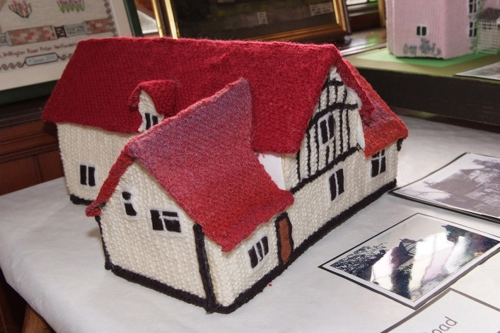 Margaret James knitted a model of the house for the knitted village exhibition.