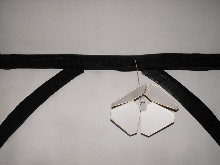 Curved windbraces to the roof