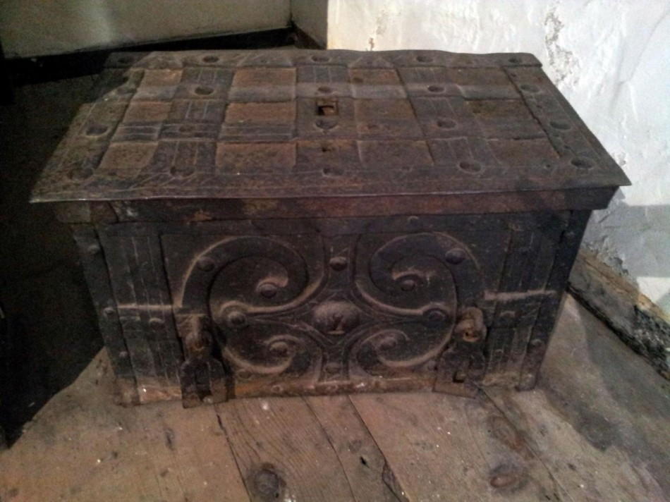 A bound and barred trunk.It was used for travelling, and was often reinforced and protected with iron bars.