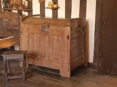 A coffer with a domed lid. Clothes were often kept in these and were kept locked.