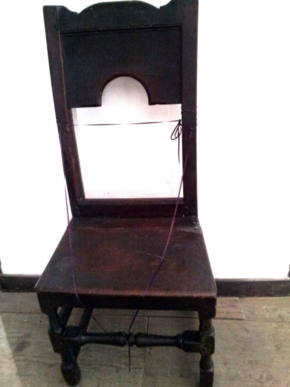 A plain wooden chair with no arms, known as a back chair or chair stool.