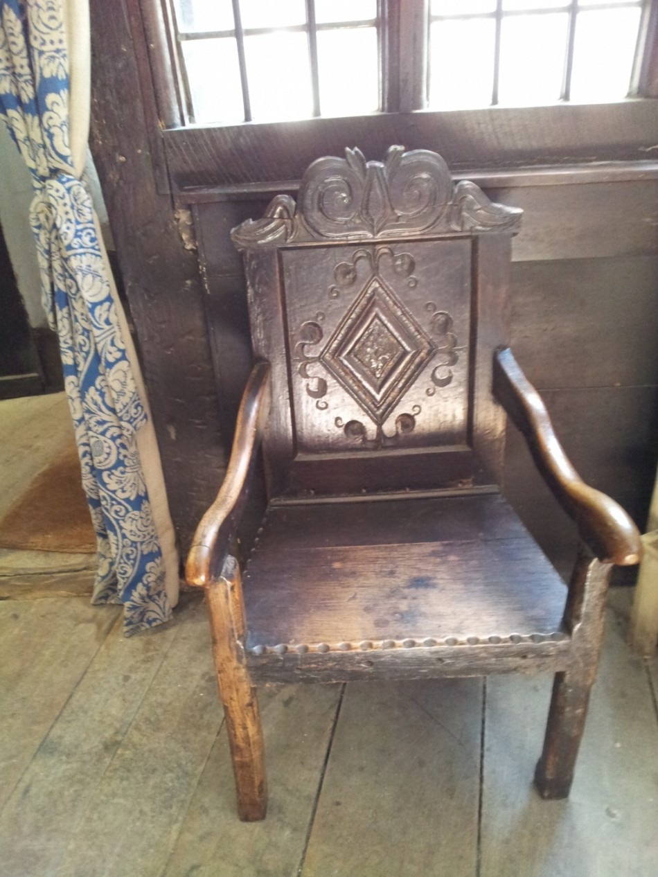 A carved armchair.