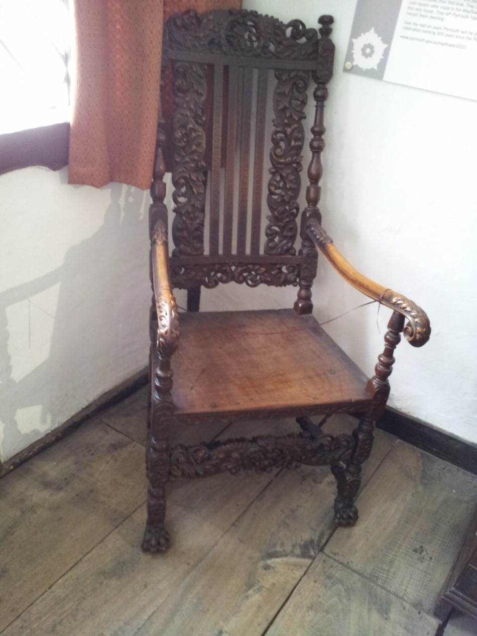 An elaborate carved chair.